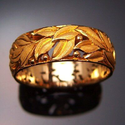 Tom Herman carved gold ring