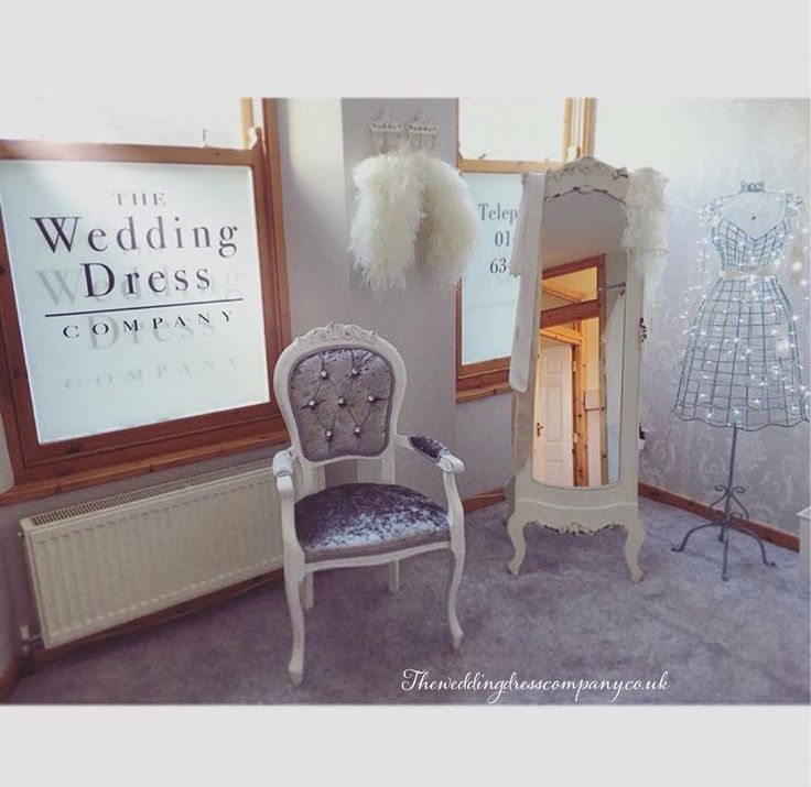 The wedding dress company bridal boutique large dressing / changing room with grey silver shabby chic decor