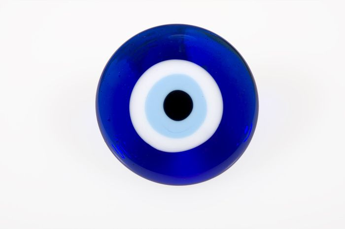 Evil eye my next tat but the eye will be the center of my dogs paw print....