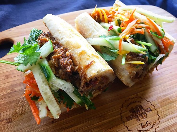 Can someone say Banh Mi?! Pork Bahn Mi with Slow Roasted Pulled Pork/Housemade Pate/Cucumber & Carrot Salad/Garlic Aioli/Hoisin BBQ Sauce/ Cilantro & Mint on a Toasted Baguette  #baguette #patr #bahnmi #holycityeats #chseats #charleston #localbutcher #neighborhoodbutcher #eatlocal