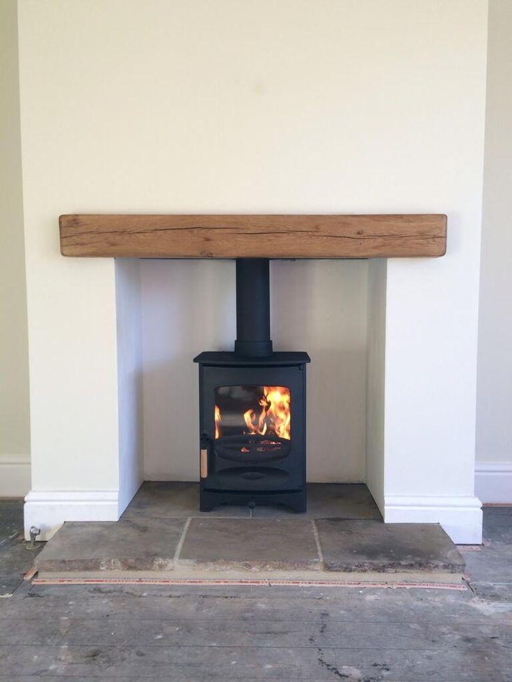 @Fahrenheit Stoves Ltd: @Charnwood C-Four, reclaimed Yorkshire stone hearth, oak fireplace beam. pic.twitter.com/fwuFRrPBpQ