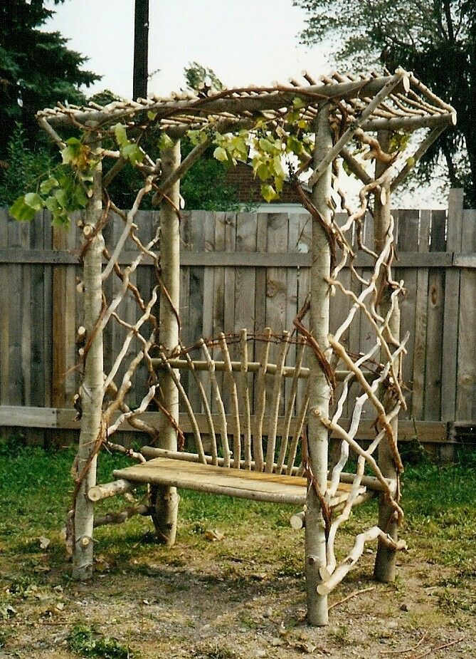 Love this rustic garden bench trellis.