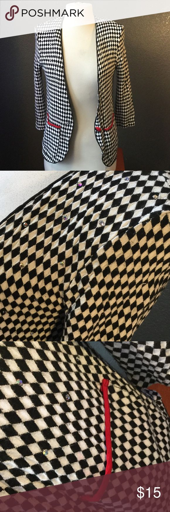 Vintage Black and White Checkered Blazer💋 This vintage piece is equipped with studs and shoulder pads This could be the perfect Piece for you ! ⚡️Reminder my shipping is fast and efficient and I'm more than willing to negotiate prices ⚡️ Jackets & Coats Blazers