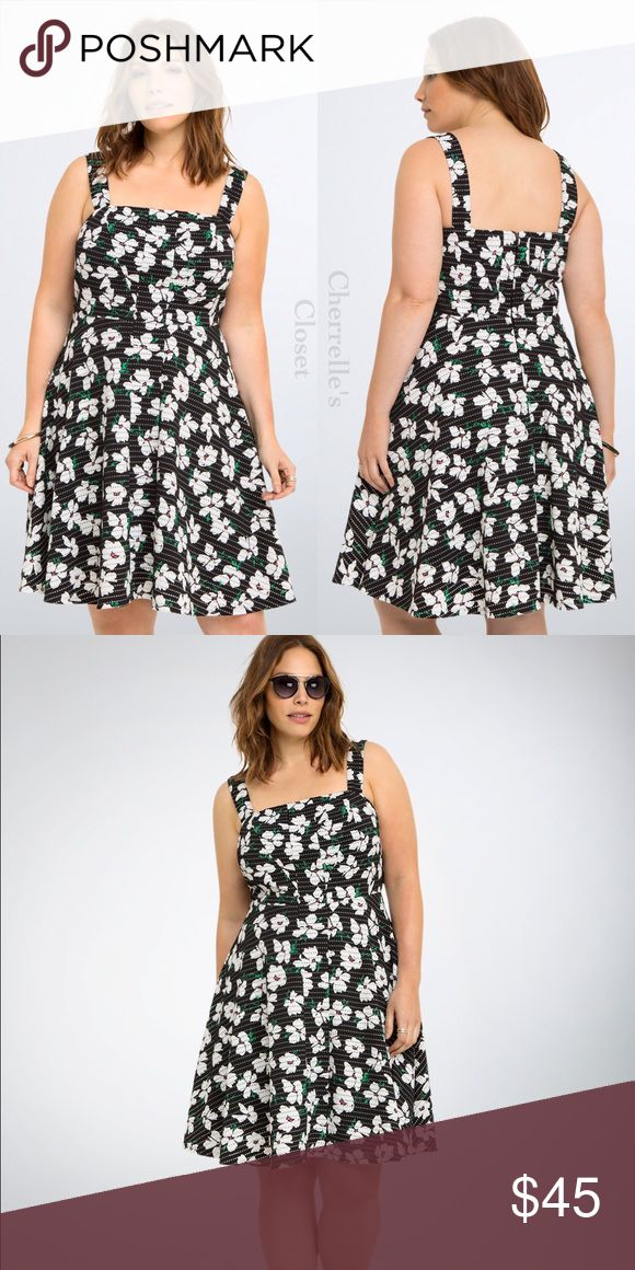 "Torrid Floral Print Texture Skater Dress Plus Size A dream of a dress that's taking you back to the retro future. This textured black beauty has subtle perforations that lend an abstract touch to the going-steady floral print. A seamed bodice has fitted quality up top, while the flared skirt is prepped for a twirl.   Model is 5'9.5"", size 1   Size 1 measures 41"" from shoulder   Polyester/spandex torrid Dresses"