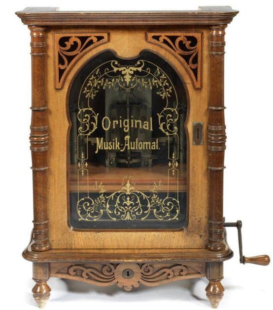 A rare 16.7/8-inch Lochmann's 'Original Musik-Automat', coin-operated upright disc musical box