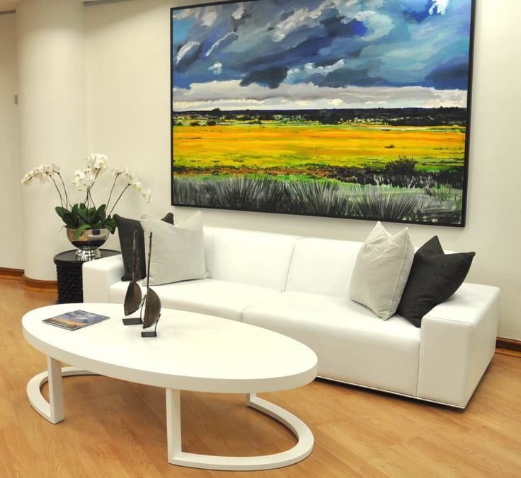 Modern, contemporary style corporate office interiors.  Colourful statement art.