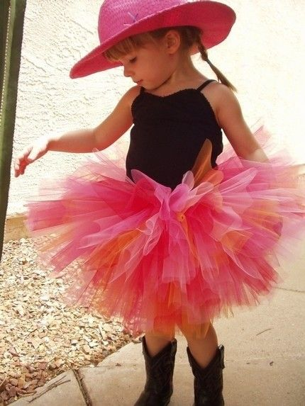 Love it, cowgirl boots and a tutu..