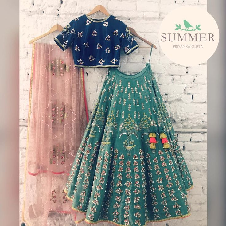 Green Bird s Umbrella Lehenga. Stunning green color lehenga and blue color crop top with pink color net dupatta. Lehenga with umbrella bird design hand embroidery classy thread work. Blouse with classy hand embroidery work. Multi color tassels gives stunning look to the lehenga. 11 November 2017