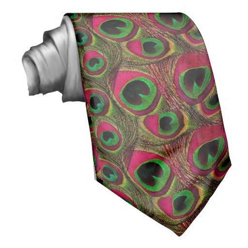 Men's tie features a repeating pattern of peacock feather eyes in shades of hot pink, fuchsia, magenta, green, burgundy, and black. This is a unique tie that is perfect to wear for peacock feather themed weddings, engagement parties, prom, and more. Order multiples for all of the groomsmen, fathers of the bride and groom, and ushers in your wedding party. #hot #pink #fuchsia #magenta #green #burgundy #maroon #black #peacock #feather #tie #men's #groom #men #prom #wedding