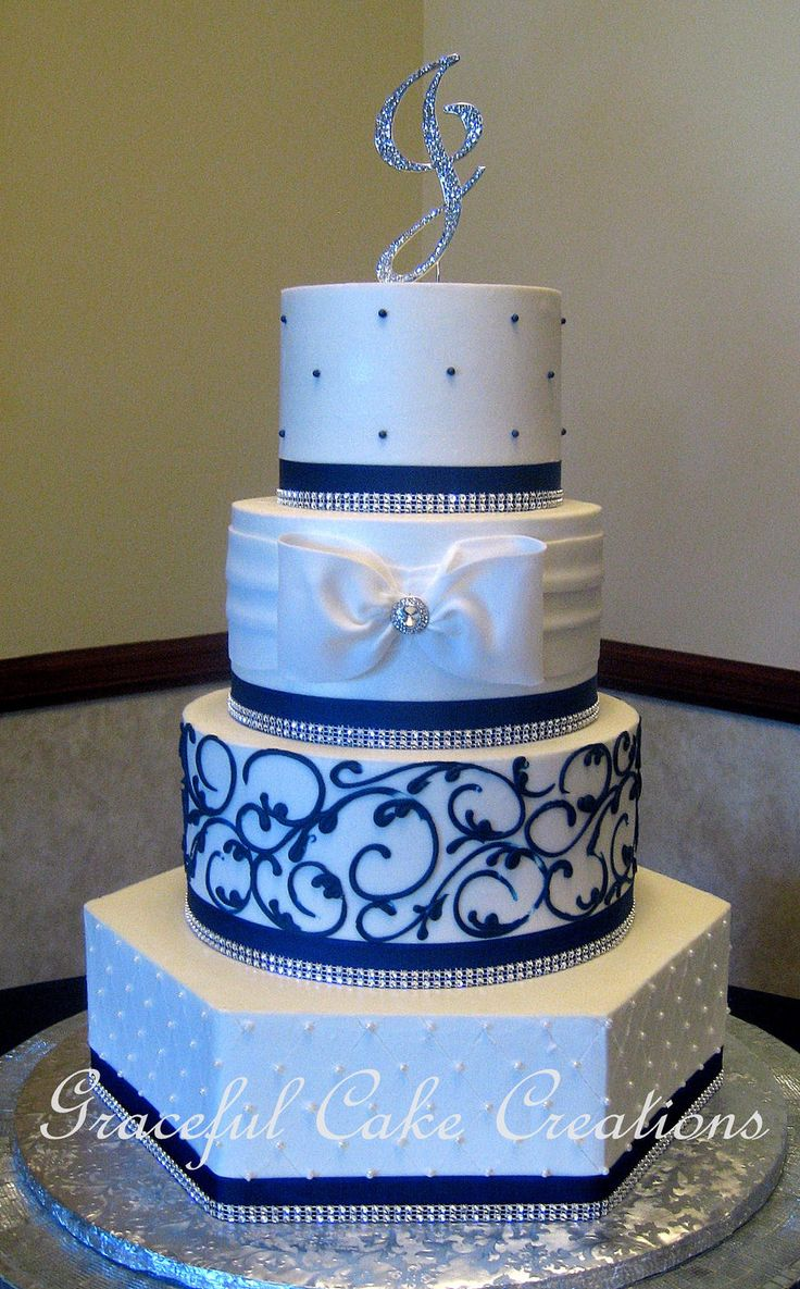 https://flic.kr/p/MUr1TJ | Elegant White Butter Cream Wedding Cake With Navy Blue Scrolls, Sugar Pearls and Ribbon With Bling