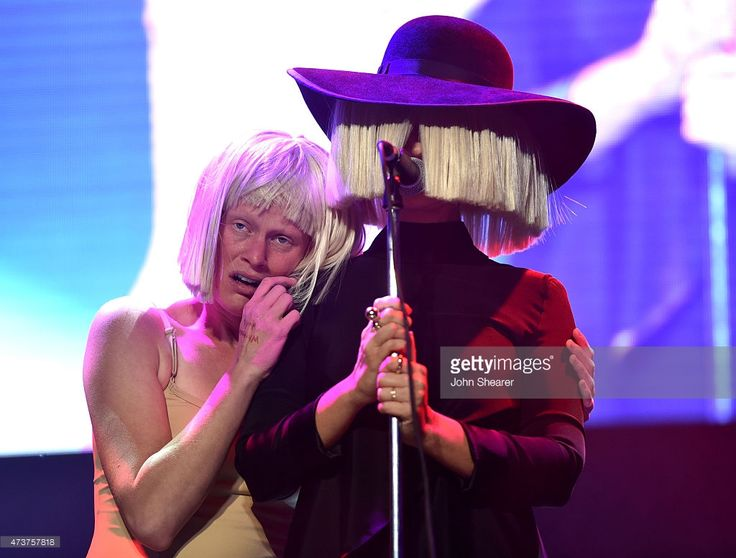 Musician Sia attends An Evening with Women benefiting the Los Angeles LGBT Center at the Hollywood Palladium on May 16, 2015 in Los Angeles, California. Description from gettyimages.com. I searched for this on bing.com/images