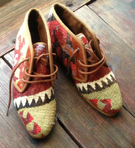 "Woven Kilim Booties. Real Turkish leather soul. Leather stacked heel. Green toe. Red inner. Sun design side on outer with leather lace border. Inside lined with velvet. Label reads: ""AT Nicholas Haslam LONDON"" Soul imprint reads size 8 10"" long (inside toe to heel) 3.25"" wide"
