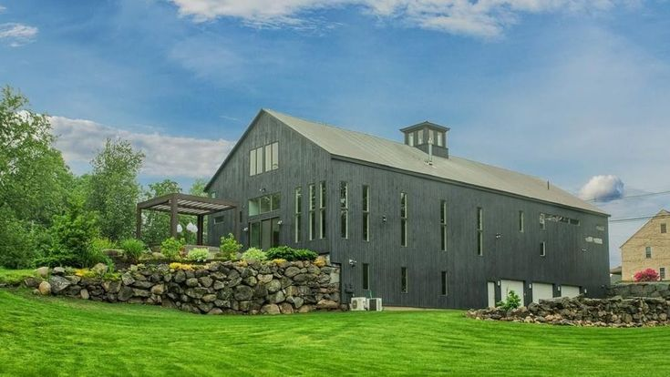 A converted dairy barn for sale in rural Massachusetts for $925,000 could have many modern design applications for its next owner.