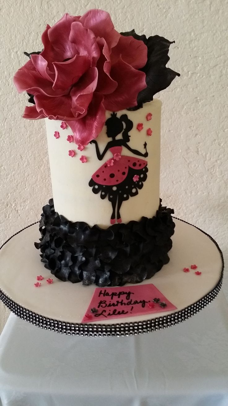 Silouette Birthday cake with a fondant rose and ruffles