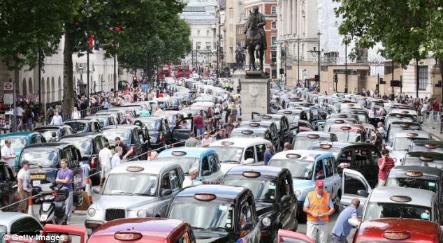 Taxis blocked Whitehall this afternoon as drivers campaigned against the introduction of the 'Uber' taxi smartphone app in the UK