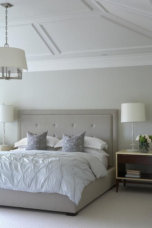 Lovely Bedroom Features A Vaulted Ceiling Finished With Decorative Trim  Moldings And A Six Light Square