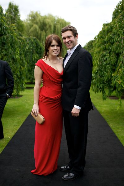 the-british-royal-family: Princess Eugenie of York with her boyfriend Jack Brooksbank. Her red dress is by Vivienne Westwood. She needs the red gown in every color.