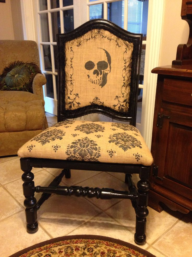 Found an old chair at a junk store. Painted it black then stenciled original and pre cut patterns on burlap. I upholstered the burlap on the chair then finished it with black eyelash gimp (looks like eyelashes). #danalihome   By Danali Home for Sinister Sisters