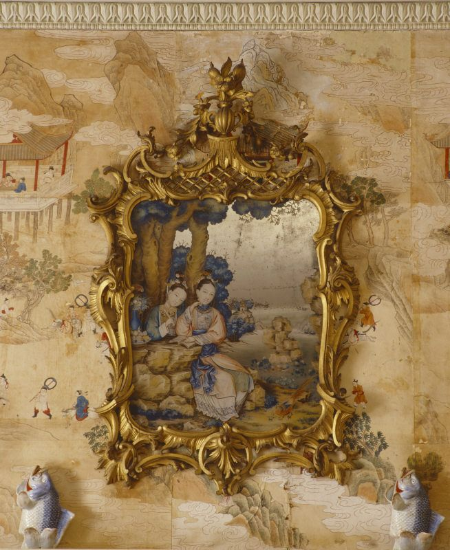 One of the Chinese mirror paintings, in English Rococo frames and with Chinese porcelain leaping carp figurines on the mantelpiece below, in the Mirror Room at Saltram. ©National Trust Images/Rob Matheson