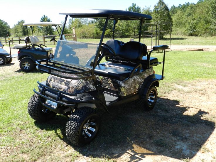 Army-Style Camouflage Painting A Golf Cart
