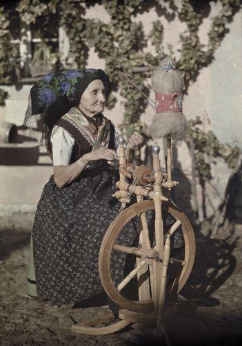 Portrait of a woman spinning yarn.  Location:Spreewald, Lower Lusatia, Brandenburg, Germany.