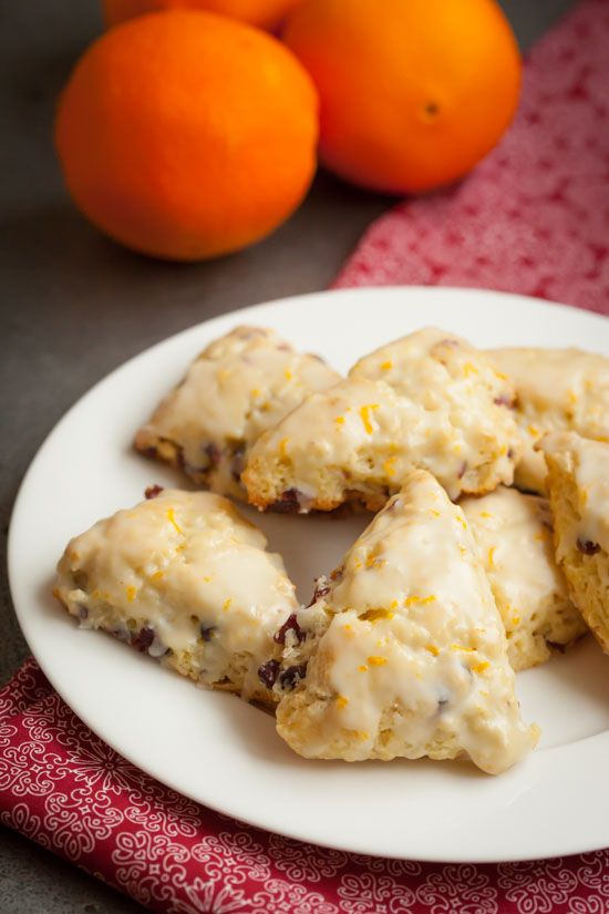 Easy and delicious Cranberry Orange Scones recipe using dried cranberries like Craisins and topped with a sweet orange glaze. These are perfect for Christmas morning or any holiday brunch or gathering! pinchmysalt.com