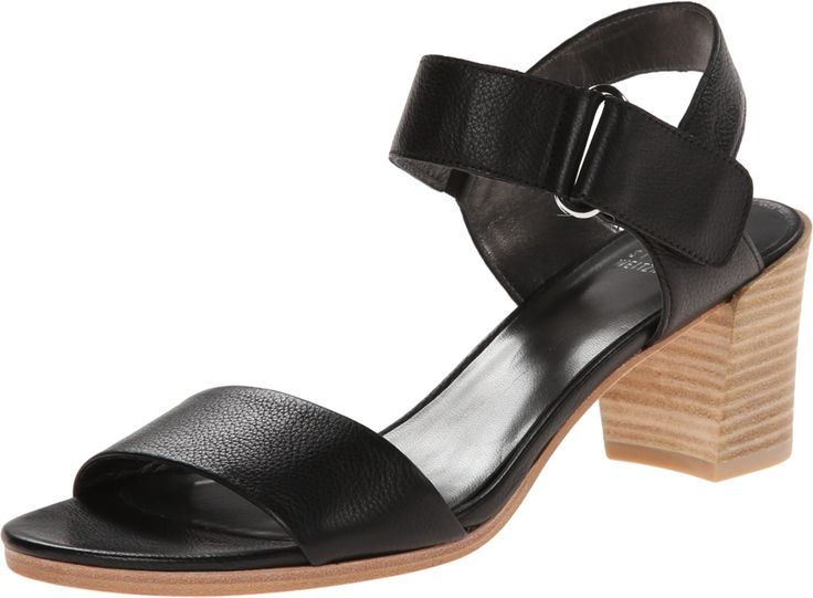 Stuart Weitzman Women's Broadband Huarache Sandal, Nero, 6 M US. Sandal featuring fixed toe strap and adjustable ankle strap with hook-and-loop closure and elastic inset. Lightly padded footbed. Stacked block heel.