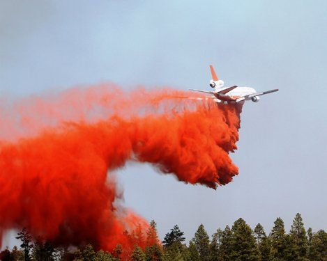 An air tanker drops a load of flame retardant on the Wallow Fire.