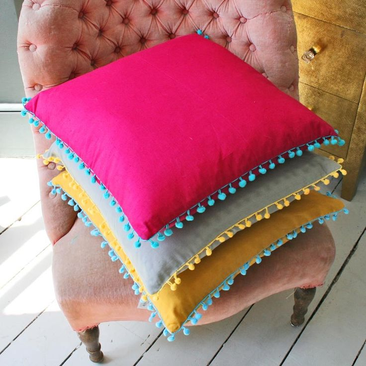 These square pom pom trim cushions add vibrancy to any room and mix well with our gypsy caravan cushion collection. Each cushion features a zip closure on the back and a feather cushion pad.