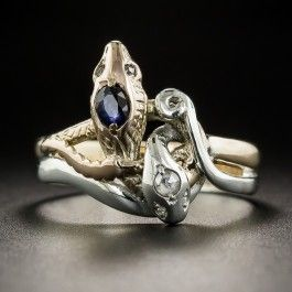 A pair of venomous vipers, going in opposite directions, find themselves in a tangle in this unique and 'striking' Victorian ring crafted in rose gold and silver. Currently ring size 10.