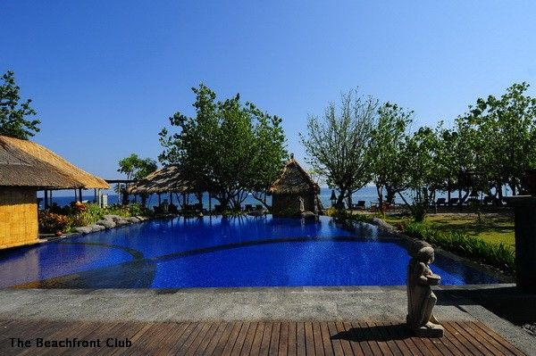 Lying between limpid water and emerald mountains, Amertha Bali Villas Beach Fron…