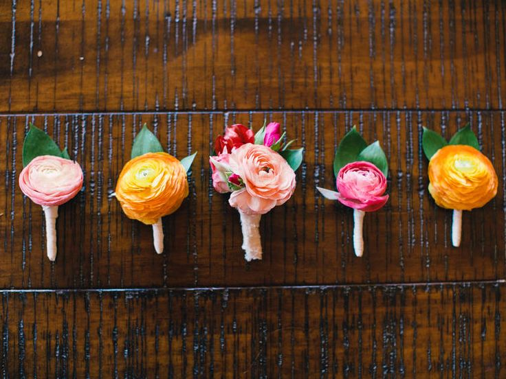 Pink and yellow ranunculus boutonnieres. Ranunculus is a cost effective rose alternative!