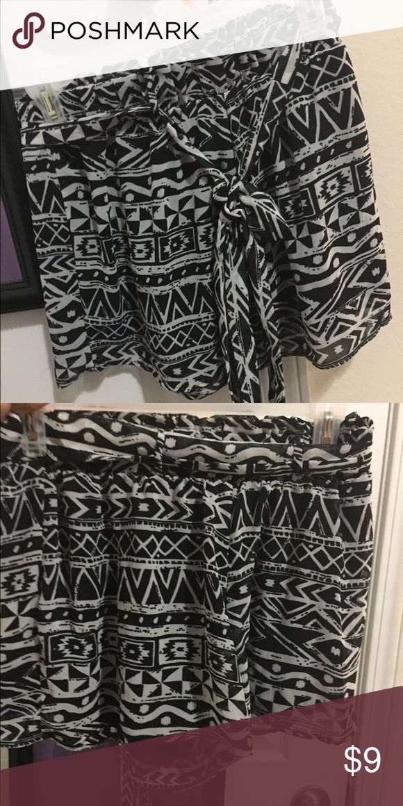 Aztec shirts with tie Black & white Aztec shirts with tie.  Worn multiple times still in good condition. mine Shorts