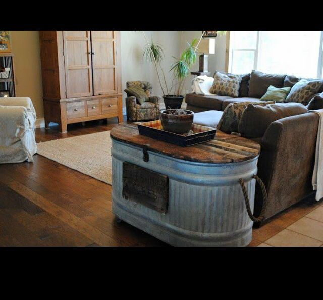Cattle tank table...Not my style, but a clever idea--and that's a lot of hidden storage space.