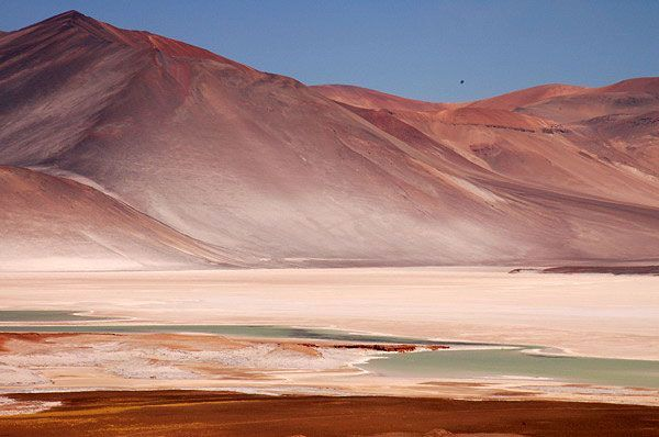 The Atacama Desert () is a plateau in South America, covering a strip of land on the Pacific coast, west of the Andes mountains.