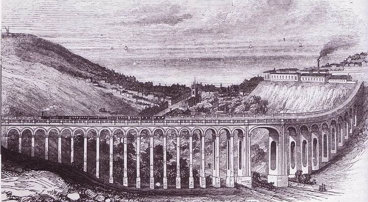 View of the London Road viaduct as built, looking towards St Peter's Church, Brighton with Brighton railway works visible on top of the cliff.