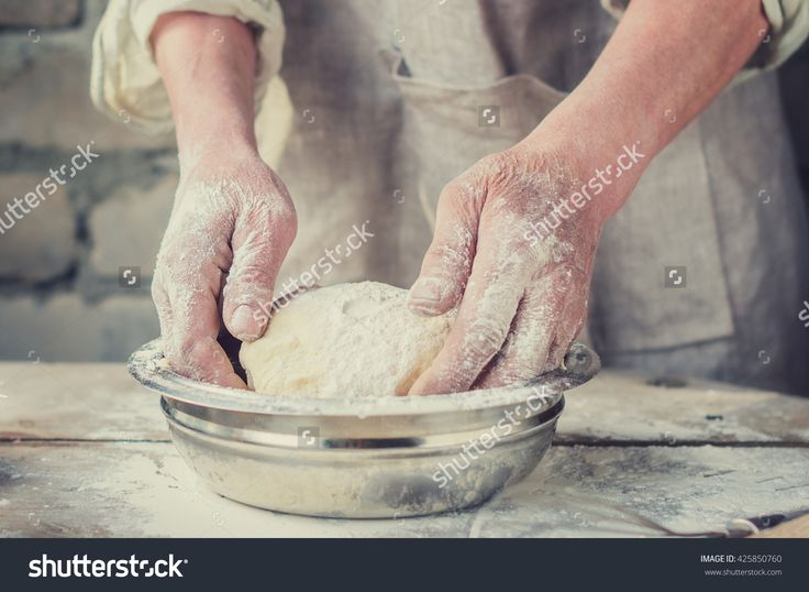 Rustic Bread On The Fermented Baked From Wholegrain Flour Of Sunflower Seeds To The Oven. Hands Of The Baker Men. The Process Of Kneading Wheat Bread. Selective Focus. Toned Image 写真素材 425850760 : Shutterstock