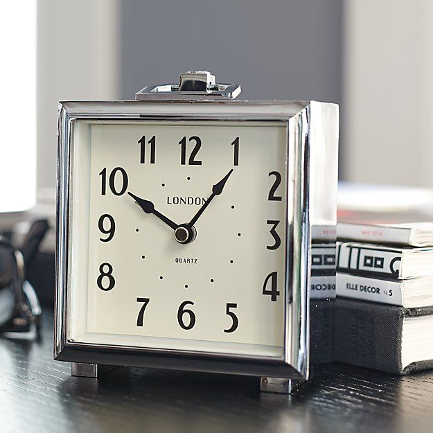 The London Clock Company, established in 1922, created this charming bedside alarm clock exclusively for us. Telling time with timeless design, the polished aluminum case features square shadowbox styling with clean squared-off feet and a chic little handle. Classic numerals line the clean, off-white face.