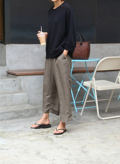 Loose linen trousers with black long sleeve tee.
