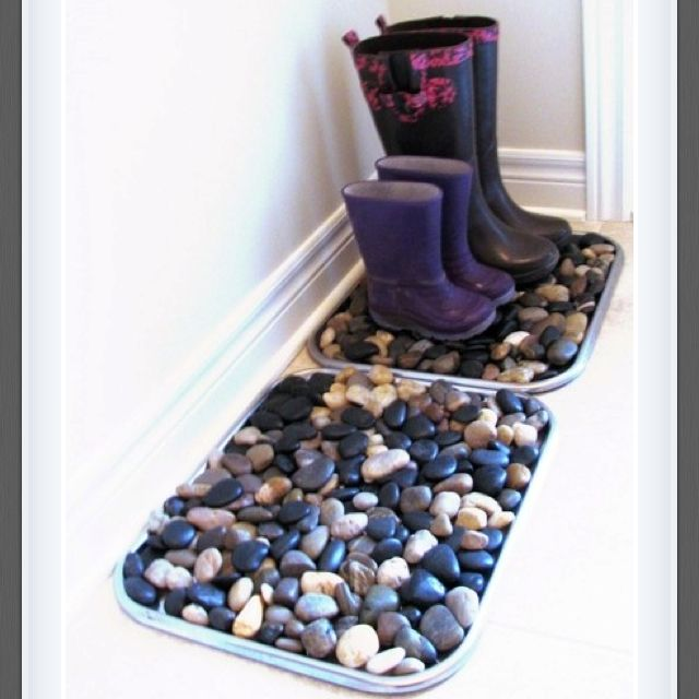 Rocks in a box (pan). Way to allow shoes to dry. Only problem I see is kids packing off the rocks!