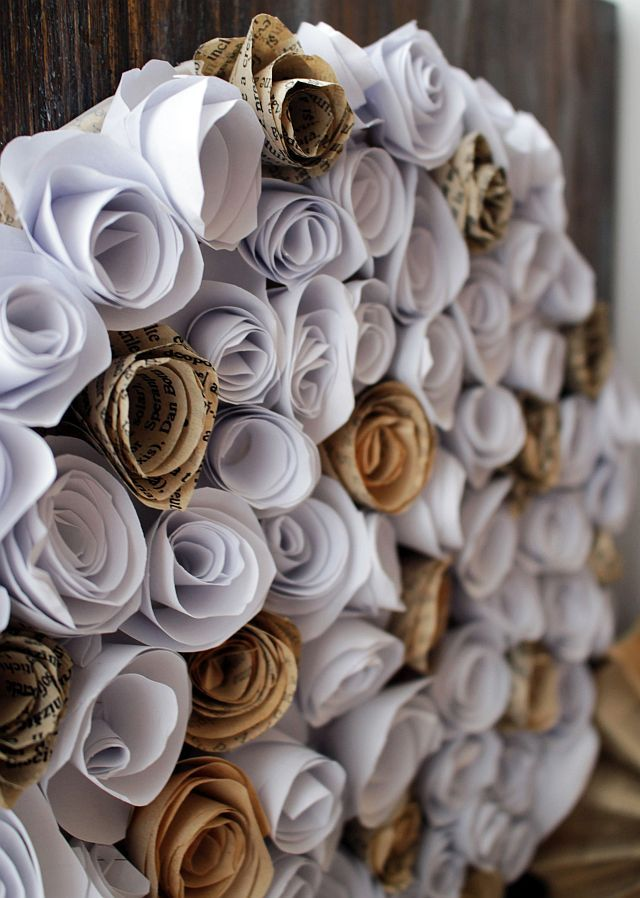 Handmade wall decor with paper flowers on wooden board