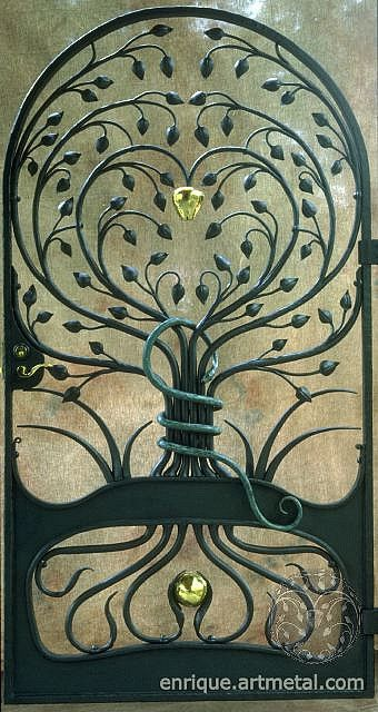 """Wrought Iron Gate - """"Tree of Knowledge""""    This wrought iron gate is made of hand forged steel with a painted graphite finish. The apple and seed pods were hand raised from soft brass - a technique used to cold form objects using repeated blows with specialized hammers and stakes. The serpent was hot forged from 1"""" solid copper bar and finished with a Verde patina."""