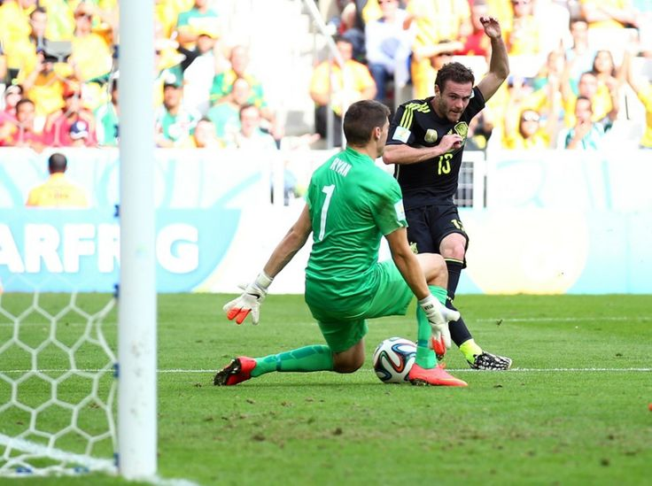 Juan Mata of Spain scores his team's third goal past Mathew Ryan of Australia
