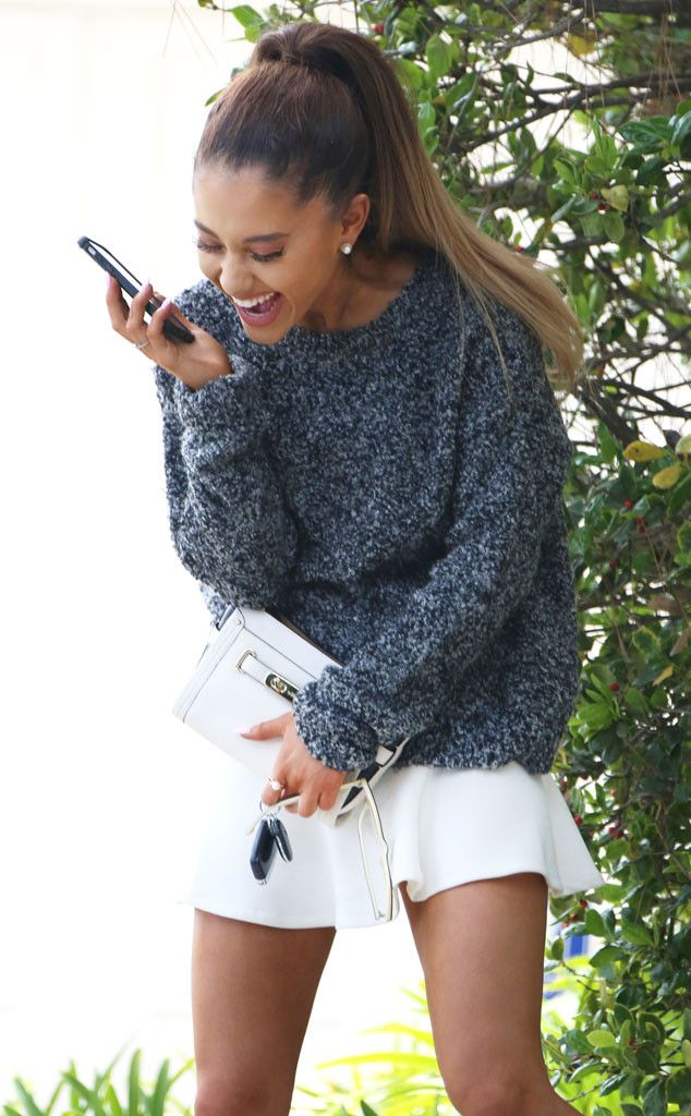 Such a cute look! Love the sweater and mini skirt combo. Ariana Grande ...