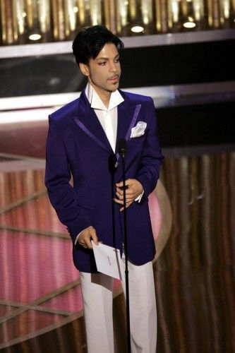 Prince — With an attitude as smooth as the silk of his button-downs and suits, Prince has no problem turning up the sex appeal or the theatrics when it comes to his personal style. Few other men have worked a ruffled collar with as much panache as this Grammy winner, and beyond the stage, his sartorial choices are equally inspired.    Photo: R. Rowell/Everett/Rex USA