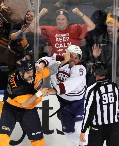 Buffalo Sabres' John Scott (32) fights with Montreal Canadiens' Douglas Murray