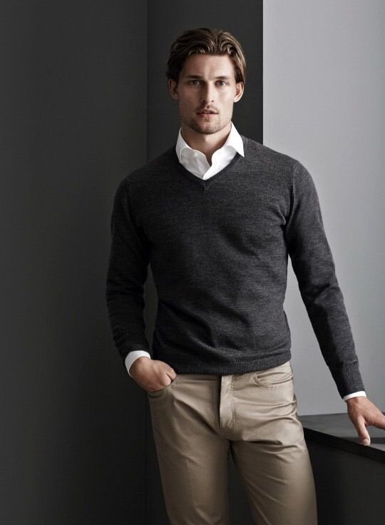 Fundamentels. Khakis paired with a white shirt and black pullover.