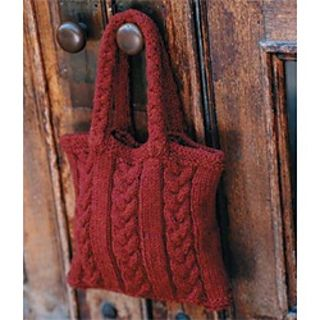 Perfect as a weekend project, Linda Cyr's fast-finishing carryall is knit in the round in alternating bands of braided cables and stockinette.