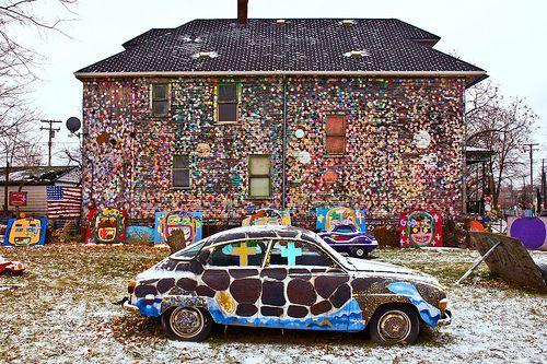 "photo by Scott Kreider. The Heidelberg Project is an art environment that spans 2 Detroit city blocks. Attaching found items on the walls of deserted homes, the heidelberg project transformed the structures into ""gigantic art sculptures."" The houses are still abandoned."
