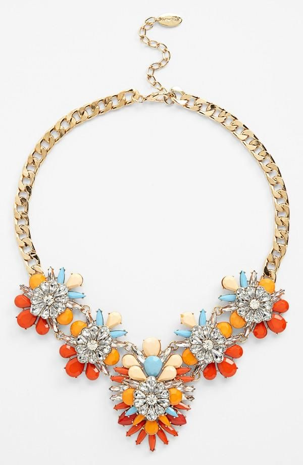 We love this crystal bib necklace! It brings summer to every outfit.